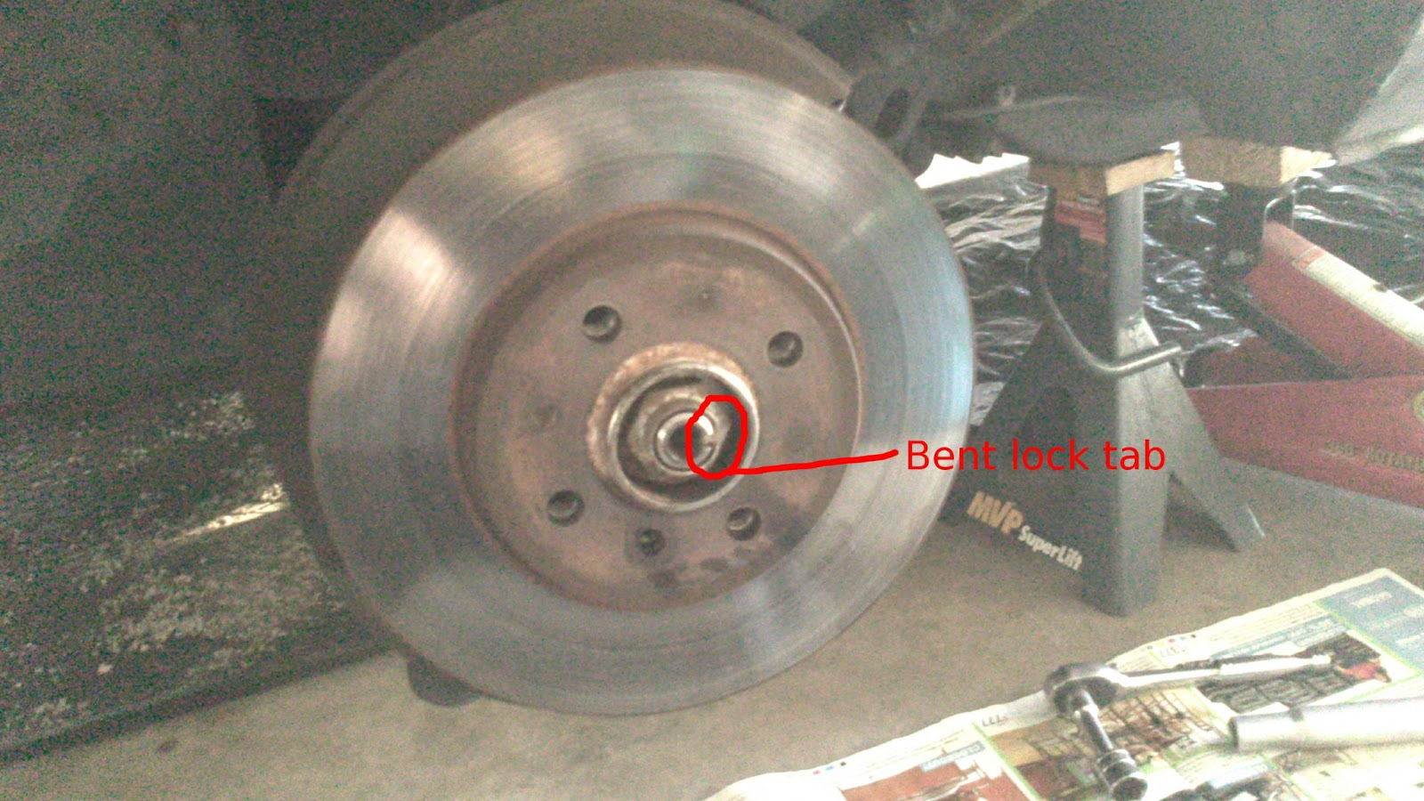E30 front wheel bearing lock tab